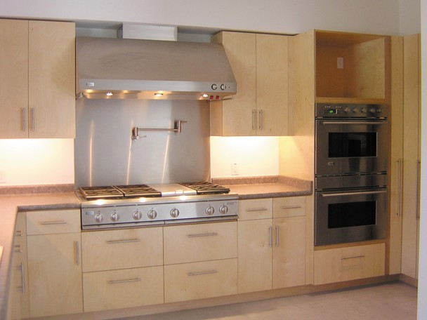 Contemporary kitchen built with natural baltic birch.