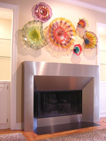 Contemporary fireplace surround built with stainless steel.