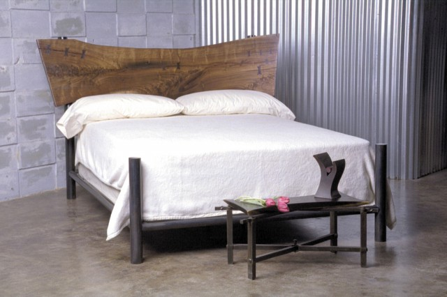 Contemporary bed built with walnut and steel. The headboard is texas black walnut with butterfly inlays of bubinga and cocobolo. The bed frame is steel. Very sculptural.