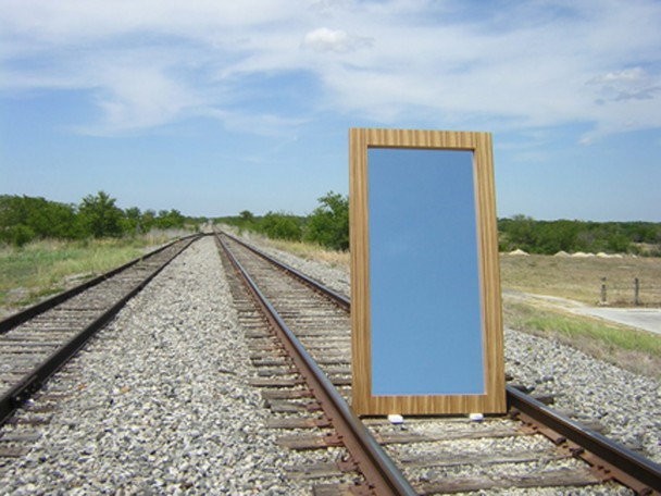 Contemporary mirror built with zebrawood veneer. This mirror is huge-aliscious. It measures 9' tall and almost 4' wide. It's photographed on the railroad tracks outside our studio in Texas.