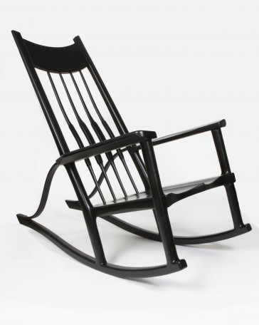 Contemporary rocking chair built with pecan. Rocking chair has a sculpted seat, high backrest, and sculpted armrests. Also features bent-laminated supports that connect the rockers to the armrests, making it look like a musical instrument. The texas pecan is painted with black lacquer.