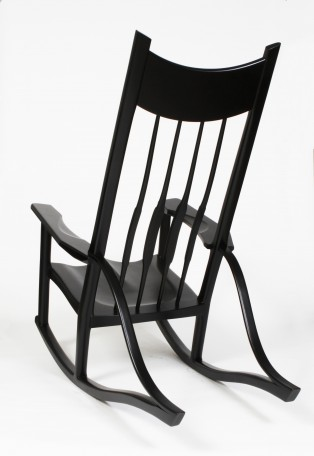 Contemporary rocking chair built with texas pecan.