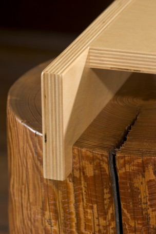 Detail image of a contemporary side table built with southern yellow pine and baltic birch. This sculptural table is part of The Umasi Collection by Ironwood Industries.