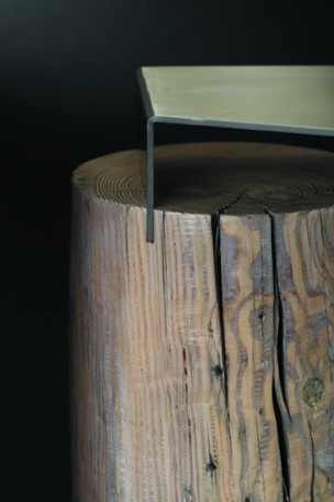 Detail image of a contemporary side table built with southern yellow pine and stainless steel. This sculptural table is part of The Umasi Collection by Ironwood Industries.